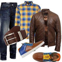 Jeans skynny, abbinato ad una vivace camicia scozzese gialla, blu, con riga rossa. Giubbotto marrone in pelle senza collo. Cintura marrone con fibbia argento. Strepitose le sneakers alte Dsquared scamosciato, logo, fantasia multicolore, stringhe, punta tonda, interno in pelle, suola di gomma, senza tacco.
