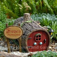 An adorable log house with sign from the Enchantment Guardian Collection from Dept. 56.