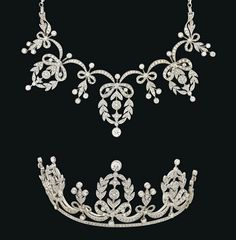 A DIAMOND TIARA / NECKLACE Composed of a series of graduated millegrain-set brilliant-cut diamond laurel wreaths, each joined by similarly-set bow design swags, interspersed with further foliate and bud spacer panels, raised on a diamond line, with detachable back chain for wear as a necklace, 5.3cm high
