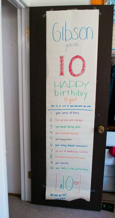 Birthday banner on door listing age number of things you love about child.