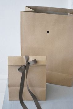 Pretty up paper bags with a fold down and ribbon