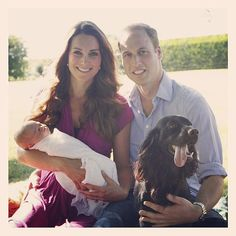 Duchess Kate Middleton holding Prince George and Prince William holding dog, Lupo.  Kate wearing dress by Seraphina.