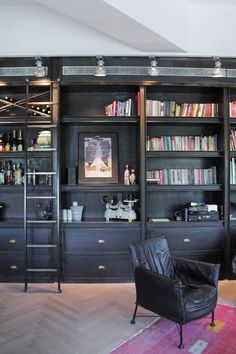 Bookcases with drawers / Industrial Living Room by Esther Hershcovich