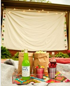 DIY outdoor Movie - Hang a sheet on the side of the house or fence instead of building something to hold it.