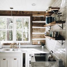 I seem to be drawn to log cabins lately. I love this simple, yet sophisticated, kitchen. via