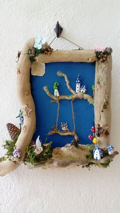 driftwood frame and fairy houses by jansfabfairies on facebook
