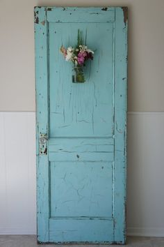 I want to replace all the doors in the house with antique ones, painted in bright colors. It'd be cute to put flowers on them like this.