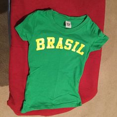 Teeny Weeny Green T-Shirt Brazil Pride Size Petite Tight Fitting T-Shirt Made and Purchased in Brazil as a Gift from a Relative, Size Petite. 20 Inches Long. Green representing the Green in the Brazilian National Flag and suspect it is commonly worn at National Brazilian Soccer Matches to show National Pride. Looks great Paired with Your Favorite Jeans. Too small for me! Care Label in Spanish but best to Wash on Gentle Cycle Cold and Hang Dry. 100% Cotton except for All Yellow Letters on the…
