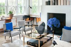 Natasha Esch of Monc XIII has created a living room with just the right balance of blue accents in both flowers and pillows and throws. We l...