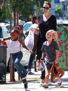 "Angelina Jolie, Shiloh and Zahara  Shiloh and Zahara Jolie-Pitt are becoming little women. Accompanied by their mom, the 5 and 7-year-old sisters recently went to a small salon in London to get their ears pierced, according to The Sun. Zahara reportedly ""screamed and burst into tears"" while getting pierced, causing Shiloh to change her mind."