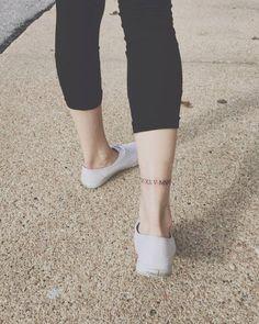 Roman numerals on Ashley's right Achilles tendon.