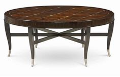 "Love this 46"" round ""Classic Contemporary"" cocktail table from Caracole...great leg lines!"