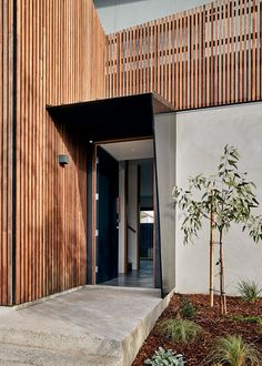 STAR Architecture Have Designed A Home With A Wood Screen Facade This modern house has a sculptural entry canopy meets the timber screen and guides visitors to the front door.