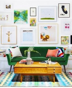 Stunning wall #gallery in bright, colorful #LivingRoom! The different sizes and shapes make this eclectic mix of wall #art the perfect addition to this gorgeous space.