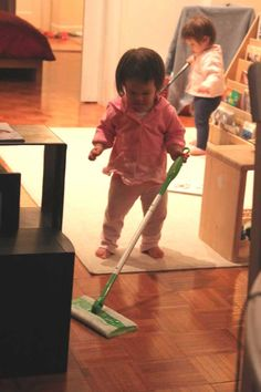 Brooke (14 months) is using a child-sized carpet sweeper and Mackenzie has her hands on a shortened Swiffer (thank you, Amy, for the idea!). Life is getting better for Mama! Stay tuned for more soon.