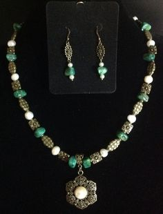 Bronze necklace set with agate and pearls