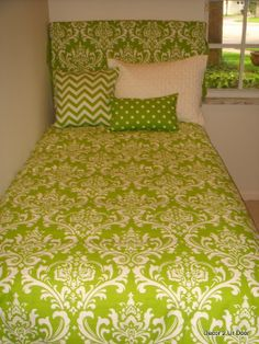 college dorm room bedding. would be absolutely perfect with black pillows instead of more green.