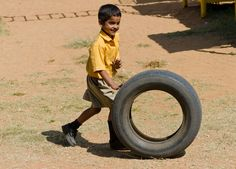 Christel House India Student playing with tire
