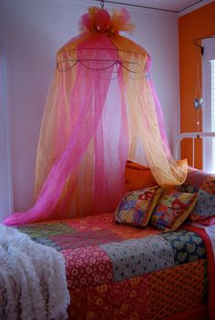 Lampshade frame turned into a bed canopy.
