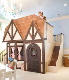 Love it! What little one wouldn't want a slide in their room.