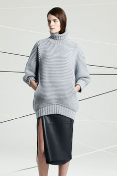 For the next winter vortex, this cozy gray blue cropped sleeved sweater and slit to there raw leather skirt are a must. Chalayan | Pre-Fall 2014 Collection | Style.com