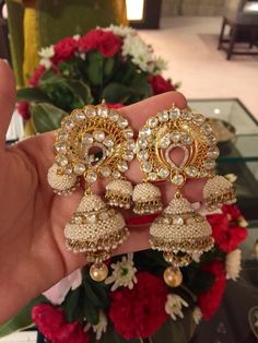 A very elegant and traditional pair of Jhumkis with pearls, diamonds and uncut diamonds from Jewels by Rakesh Khanna.