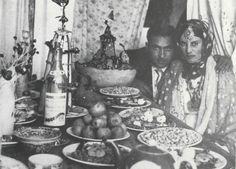 Jewish couple at the khanch-e hana [henna table] for their henna ceremony, Herat (Afghanistan), mid-20th century