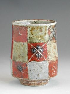 Sarah Walton/  Sarah Walton b 1945  Saltglazed stoneware Yunomi made at Polegate, East Sussex 70's    Yunomi decorated with an incised squared panel pattern infilled with ash glaze and iron slipped decoration.