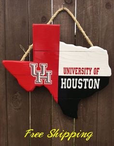 Rustic Wooden University of Houston Texas Shaped Flag Door/Wall Hanging with soft backing to protect your wall or door. This is a great way to show the Cougar Pride! Its customized to say any message, quote, or name.  16 inches from left to right, by 14 inches from top to bottom. Front to back is one inch.