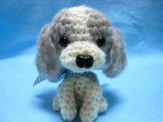 This little Shih Tzu dog is 4H. She is crocheted in fuzzy gray/tan Alpaca blend yarn and fuzzy cream yarn. Her nose and eyes are black plastic. Just a