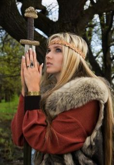 Viking girl warrior with sword in a wood Stock Photo - 9780825