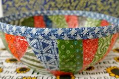 Decoupage bowl made with fabric scraps.