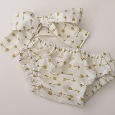 A personal favorite from my Etsy shop https://www.etsy.com/listing/250084550/diaper-cover-white-with-gold-arrows-girl