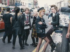 70s Punk Fashion -  consisted of young alientated teens wearing messy baggy ripped up clothes. Boys normally wore balck leather and girls wore micro minis with black fishnet stockings. (Survey of Historic Costume)