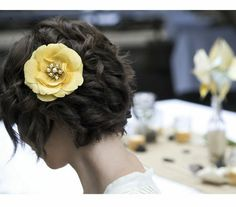 Green bride wearing a vintage yellow flower hair clip | A Vintage And Recycled Real Green Wedding In Portland, OR