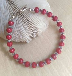 Red Coral Bracelet! Sterling Silver and twinkling silvery Swarovski crystals! Check out this item in my Etsy shop https://www.etsy.com/listing/266857612/brilliant-red-coral-silvery-swarovski