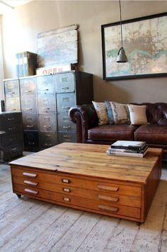 Map drawers as a coffee table. West End Salvage- you can find it all there!
