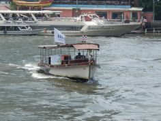 Complimentary Hilton Shuttle Boat which takes you from one side of the river to the other at the Millennium Hilton Hotel in Bangkok, Thailand
