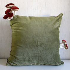 handmade cushions featuring some mushrooms growing out of them by Helsinki based designer Suvi-Tuuli Junttila.