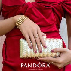 Look stunning for any holiday outing with PANDORA Jewelry. Add glamour gold accents such as layered 14k gold PANDORA bangles and a cute clutch. You will be sure to stand out.