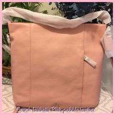 Coach pink Isabella pebble leather shoulder/hand Coach pink Isabella pebble leather, shoulder and hand bag belts! New with dust bag, measuring 14x15, beautiful bad lots of room inside &!has an out did pocket! I purchase this for my daughter, she is small & said the bag is too big for her! Upset about that! It's a beautiful bag! Coach Bags Shoulder Bags