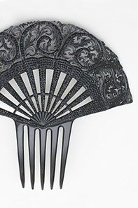 Intricately carved plastic comb, c.1910