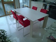 Tavole ceramic extendable dining table with red Layla dining chairs. Table and chairs available in many different colours. Delivered to our client in Cambridge.
