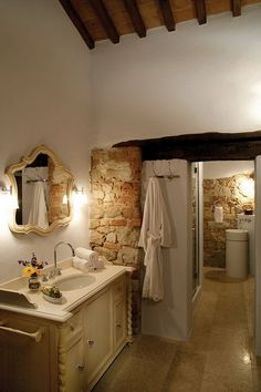 I just need to stop pinning ideas for bathrooms right now this has it all stone stucco warmth heighth snug...perfect!