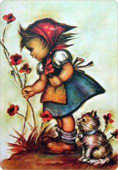 Meisje plukt bloemen ... poesje kijkt toe.
