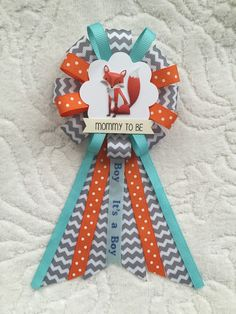 find this pin and more on ribbon corsages mommy to be ribbon corsage for baby shower