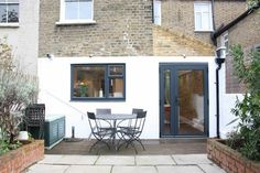 A simple side return extension by Simply Extend to a property in Finsbury Park, North London created a fantastic kitchen and dining area for the family. Exposed brick was left on the side wall to the kitchen which created a lovely feature. Kitchen Extension Exterior, Kitchen Extension Terraced House, Kitchen Extension Side Return, Brick Extension, House Extension Plans, Side Extension, House Extension Design, Extension Ideas, Conservatory Extension