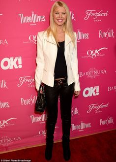Keeping it casual: Tara Reid dressed down and covered up in a black top, jeans and boots a...