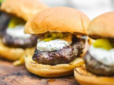 A gryo-spiced beef-and-lamb mixture is formed into little patties, grilled, and topped with tzatziki and pickled peperoncini for one tasty sandwich.