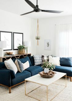 modern boho living room decor with blue velvet sofa and gold coffee table, navy sofa and boho pillows in living room design decoration Step Inside an Austin Home That Pairs Cozy Neutrals With Loads of Art Boho Living Room, Living Room Modern, Interior Design Living Room, Home And Living, Cozy Living, Blue Couch Living Room, Living Room Tables, Living Room Artwork, Living Room Lamps